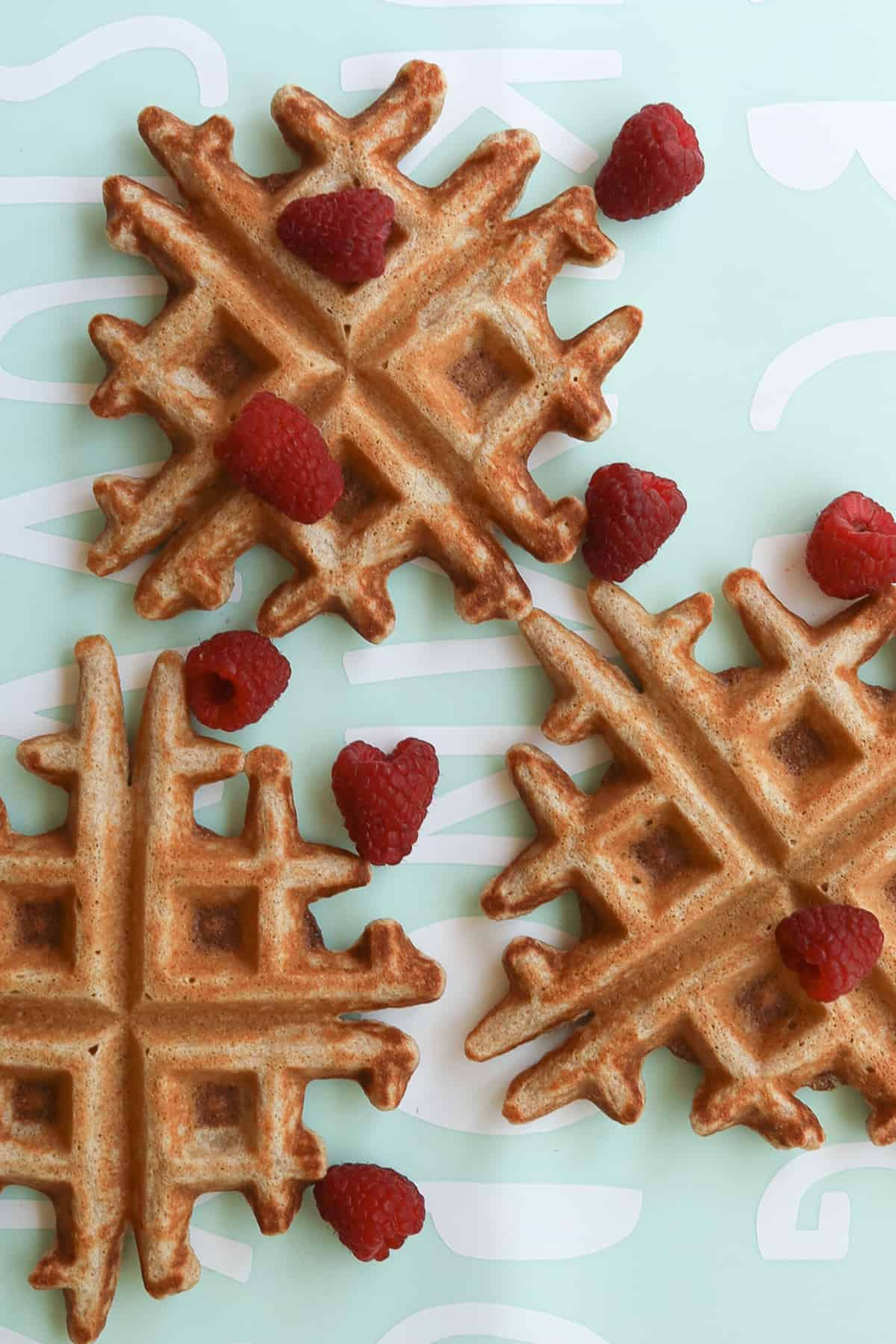 3 small size waffles with scattered raspberries