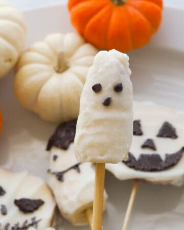Frozen banana stick covered with yogurt with chocolate eyes and mouth