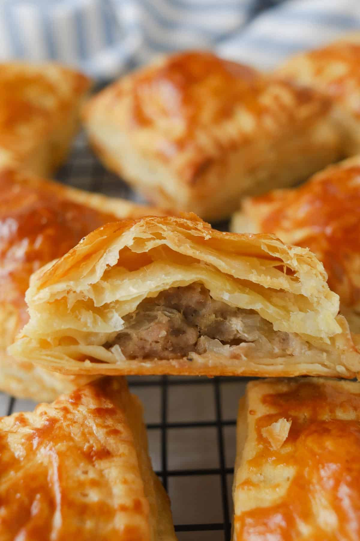 Closeup of puff pastry cut in half with meat inside