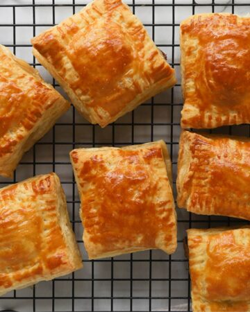 Golden puff pastries on a cooling rack