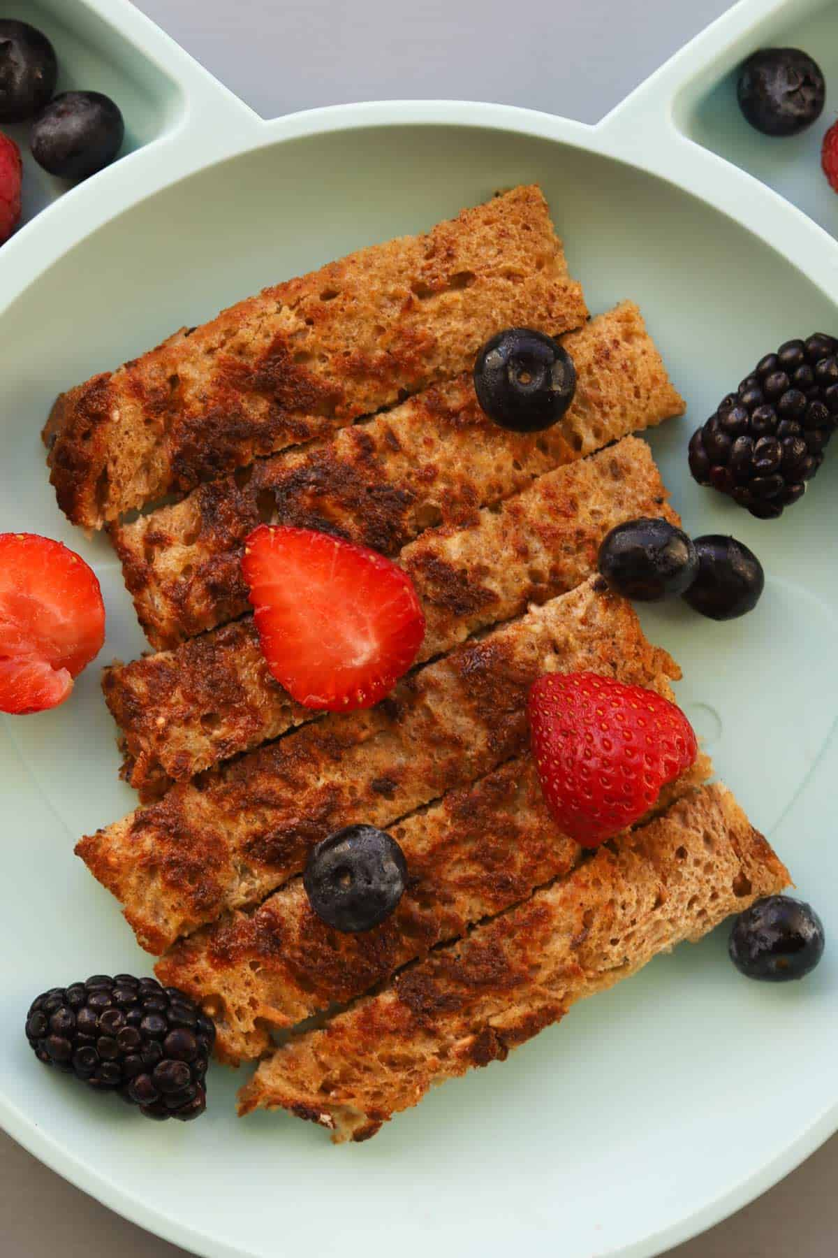 Piece of cooked bread cut into thick slices. Garnished with berries.