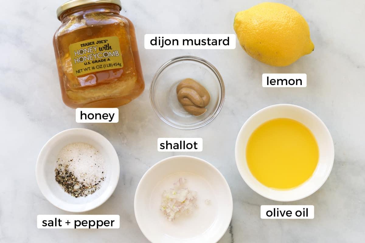 Ingredients for lemon dijon vinaigrette on a table.