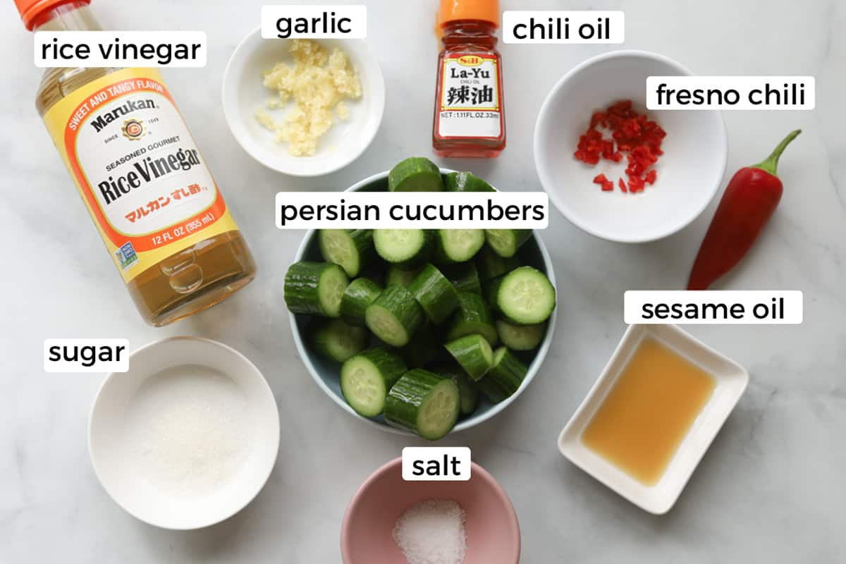 Ingredients on a table to make cucumber salad.