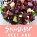 Beet and cucumber salad topped with mint leaves and feta crumbles.