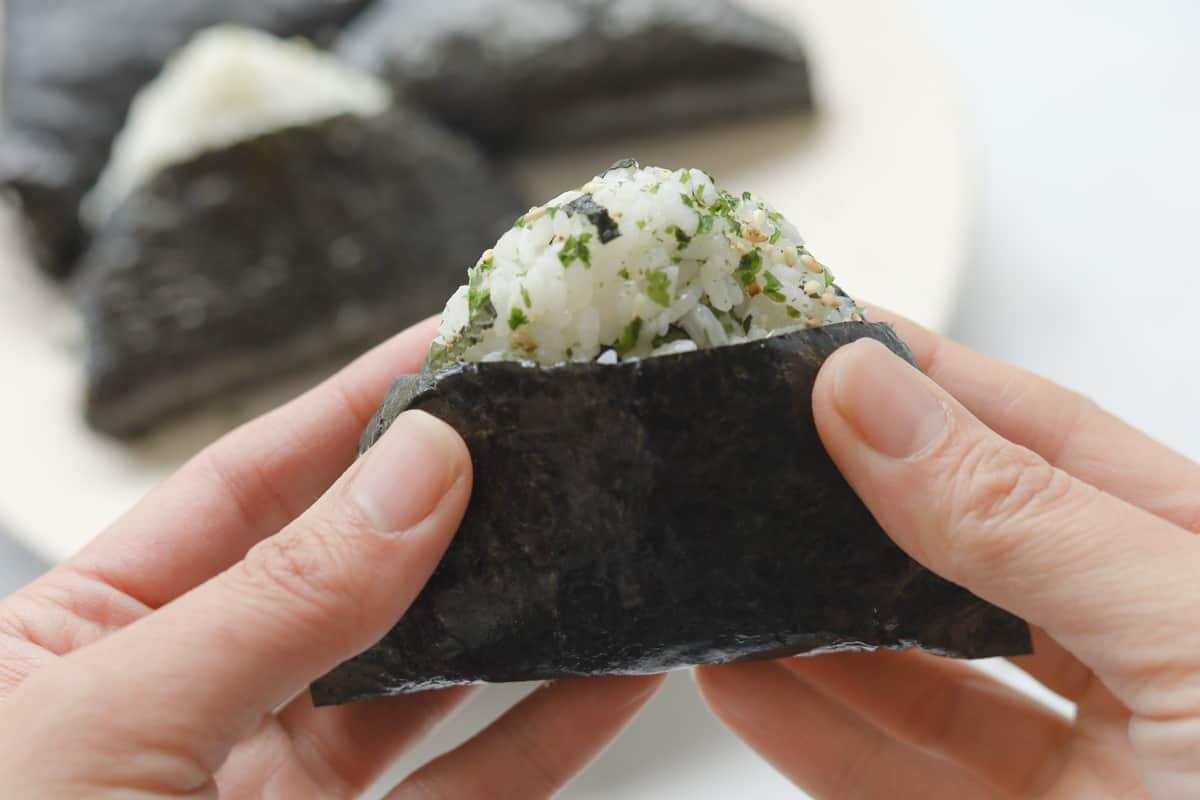 closeup image of onigirl triangle rice.