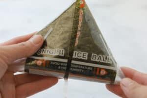 Unwrapping of rice triangle onigiri.