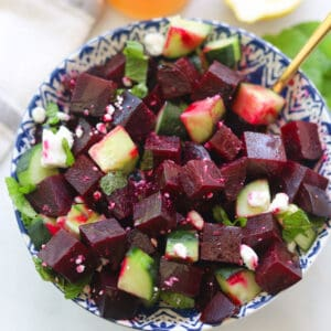 Beet and cucumber salad in a bowl.