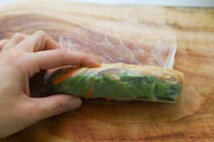Rolling a spring roll.
