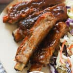 Ribs with barbecue sauce on a plate.