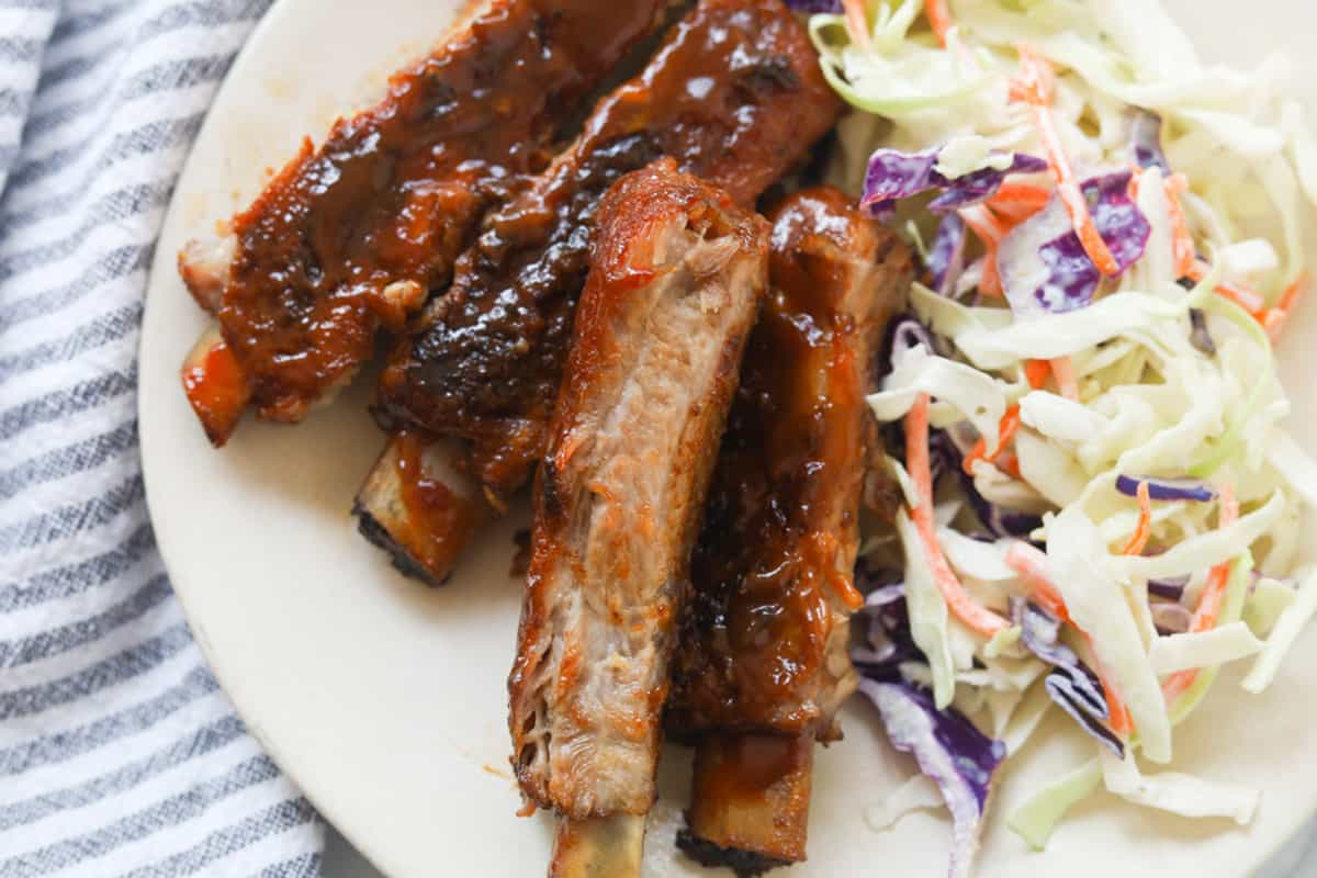 Ribs with salad on a plate