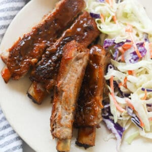 Ribs with salad on a plate.