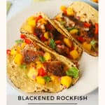 Fish tacos with mango salsa on a plate.