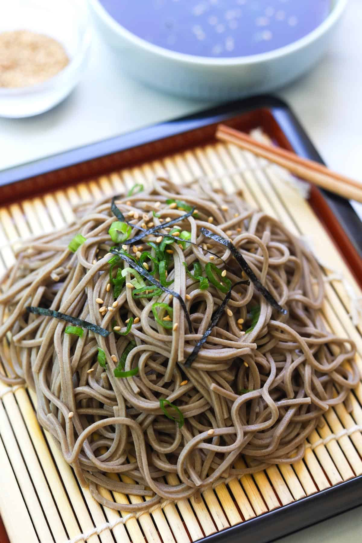 Noodles on bamboo mat.