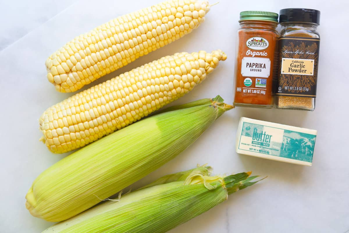 Ingredients to make seasoned corn on the cob.