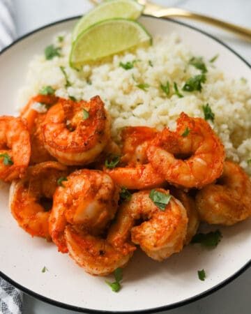 Plate with cauliflower rice and shrimp.